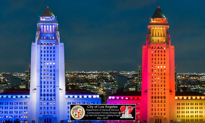 four images of los angeles city hall in the night lit up with different colored lights